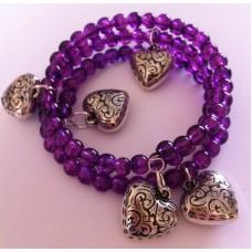 Zelf-maak-pakket spiraal armband met paarse glaskralen en bedels