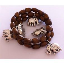 Zelf-maak-pakket spiraal armband met bruin houten kralen en bedels
