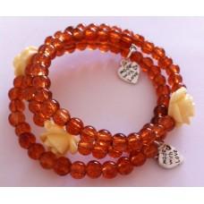 Zelf-maak-pakket spiraal armband bruin met beige roosjes en bedels