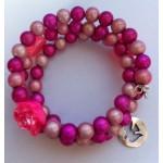 Spiraal armband licht roze / donker roze met roosjes